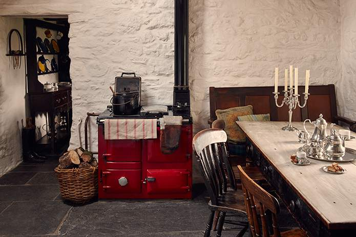 Wood-burning range in the country kitchen at Bryn Eglur, The Welsh House, Carmarthenshire