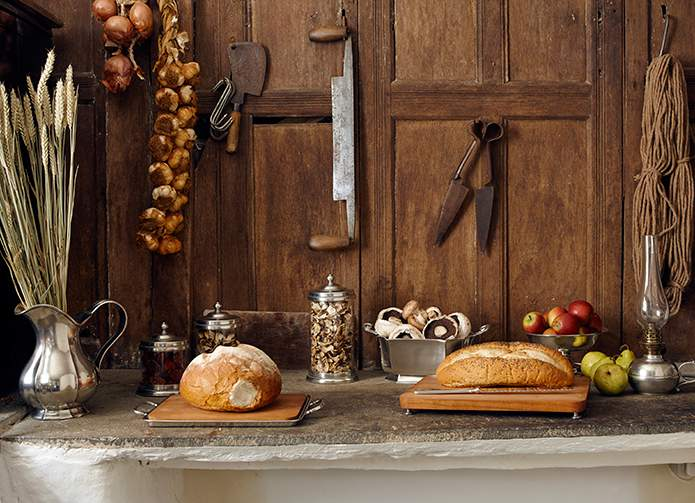 Country cottage style - handcrafted Italian pewter mixed with vintage farming finds add realism to the rustic look in the dairy, The Farmhouse, Corner of Eden, Cumbria