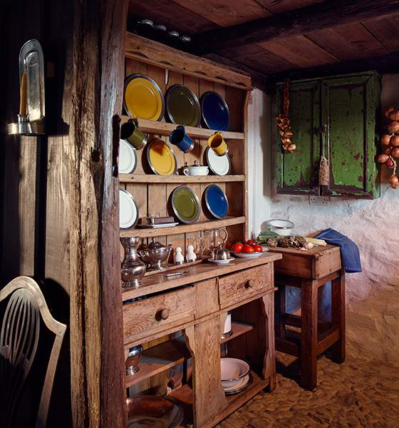 Charming crockery stored in solid wood dresser in rustically-real kitchen at Ty Unnos, The Welsh House, Carmarthenshire