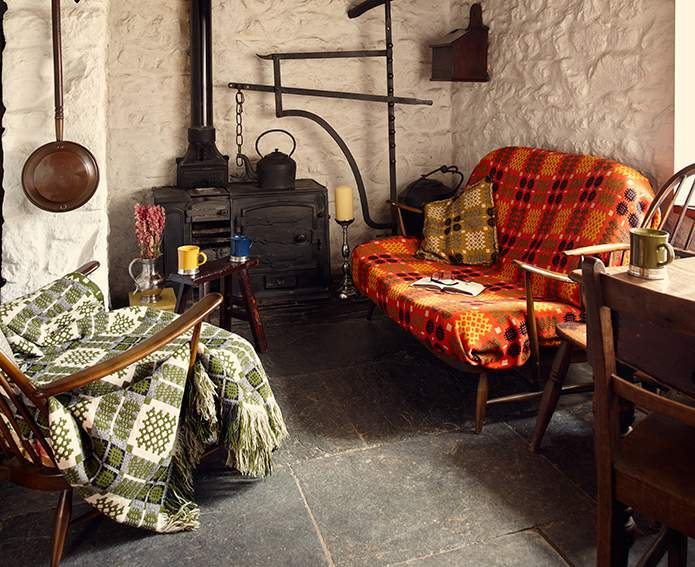 Antique range and metal implements dot the cosy parlour at Bryn Eglur - The Welsh House, Carmarthenshire