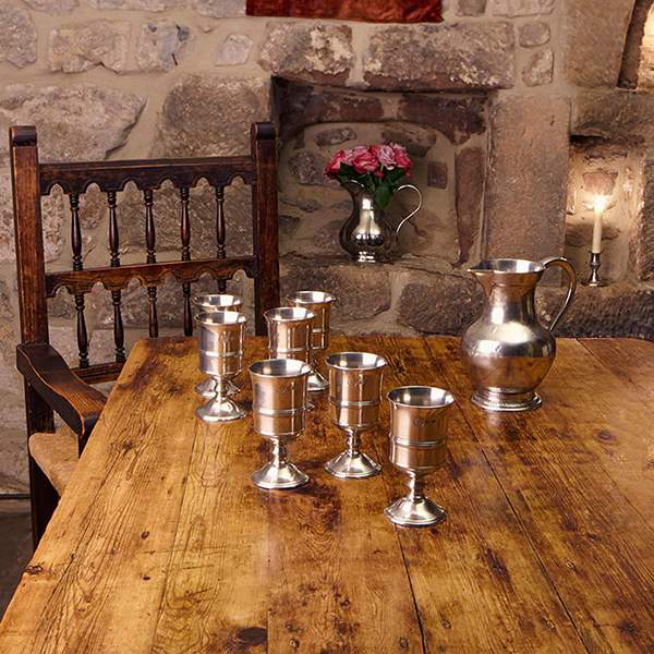 Pewter paired with wood and contrasted against stone creates a subtle grandeur at The Chapel, Harthill Hall, Bakewell, Derbyshire