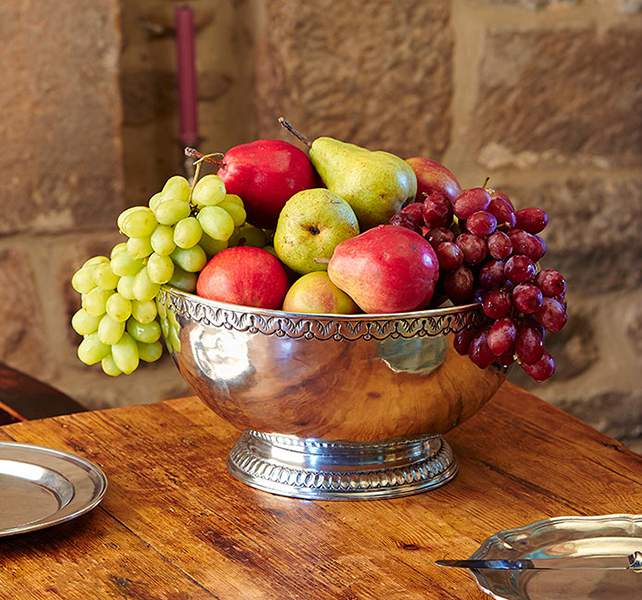 Overflowing fruit in a boundless bowl, reflections playing off the pewter creates a modern-day still-life at The Chapel, Harthill Hall, Bakewell, Derbyshire