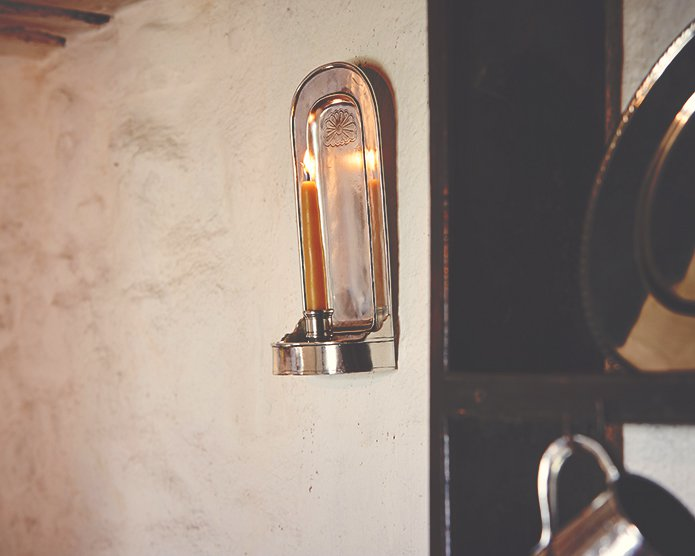 Pewter wall sconce imbues subtle lighting at Bryn Eglur, The Welsh House, Carmarthenshire