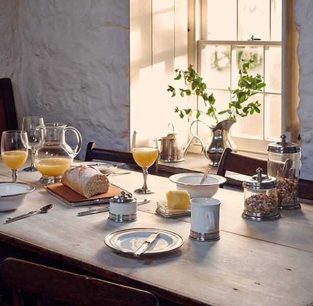 Crisp white ceramic make a tastefully laid table at Bryn Eglur, The Welsh House, Carmarthenshire